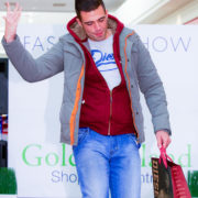 photograph of male model on catwalk